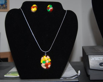 This is a  necklace with earrings made with chicklets and epoxy resin.