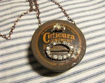 Altered Vintage Cuticura Can Locket Necklace, chain 26 inces long