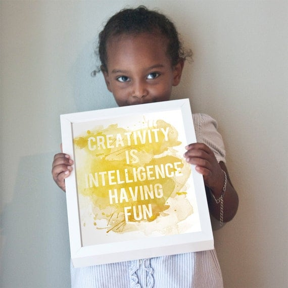 Creativity is Intelligence Having Fun print in yellow and gold