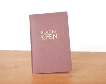 eggplant handmade journal: peachy keen