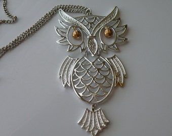 20% off Wise Owl pendant. Silver tone, gold tone metal. Articulated. 1970s.