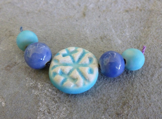 https://www.etsy.com/listing/166204492/winter-blue-porcelain-snowflake-bead-set?ref=shop_home_active