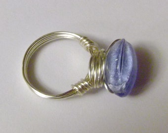 Wire wrapped blue glass bead ring. 20 gauge silver tone wire . Handmade. Half inch diameter bead.