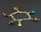 Sterling silver chain bracelet with Venetian glass hearts.Murano glass heart charm silver gold bracelet Women's sterling silver bracelet.