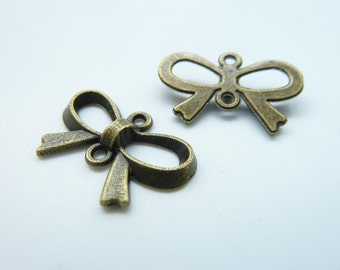 40pcs 14x22mm Antique Bronze Lovely Butterfly Bow Connector Link Charm Pendant c773