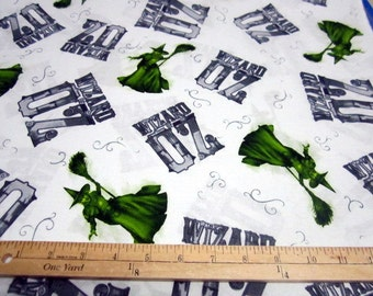 Wizard of Oz 75 Years of Wickedness - Oz and Witch Tossed on White/Grey Fabric by Quilting Treasures