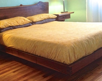 Live edge walnut platform bed.