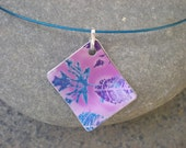 Printed Aluminium Pendant with Leaf Design in Purples and Blues.