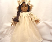 Nightgown, night cap, and pantaloons for 18 inch dolls.  Unbleached muslin with 1/2 inch ecru lace trim.