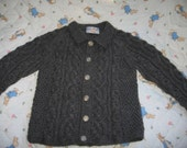 Irish fisherman sweater for 2 year old boy. Celtic design and blarney kiss are the main designs