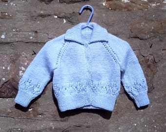 "Hand knitted baby girls blue cardigan. 20"" chest."