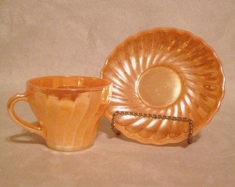Vintage fire king coffee cup with saucer.  Vintage fire king luster orange coffee cup with saucer. Vintage fire king cup with saucer