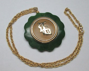 unusual green bakelite / catalin necklace with a japanese or chinese symbol