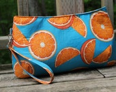 Large sized Citrus clutch in turquoise with removeable wristlet strap.
