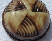 "Vintage celluloid air puffed button, high dome with triangular design, 1.25"" ins across. Cream and brown tones. PFM13.4-3.30-1."