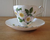 A Vintage Wild Rose Teacup and Saucer