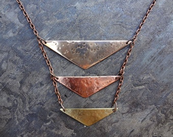 Hammered bronze, copper and brass necklace with copper chain. Mixed metal geometric chevron boho hammered bib necklace for women and teens.
