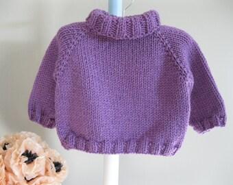 Handknit baby sweater.........purple turtleneck