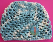 Crochet baby beanie in blues with seahorse button