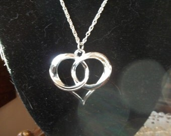 Large silver heart pendant on chain
