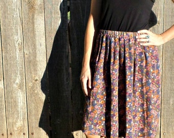 Beautiful Floral Accordion Pleat Midi Skirt.