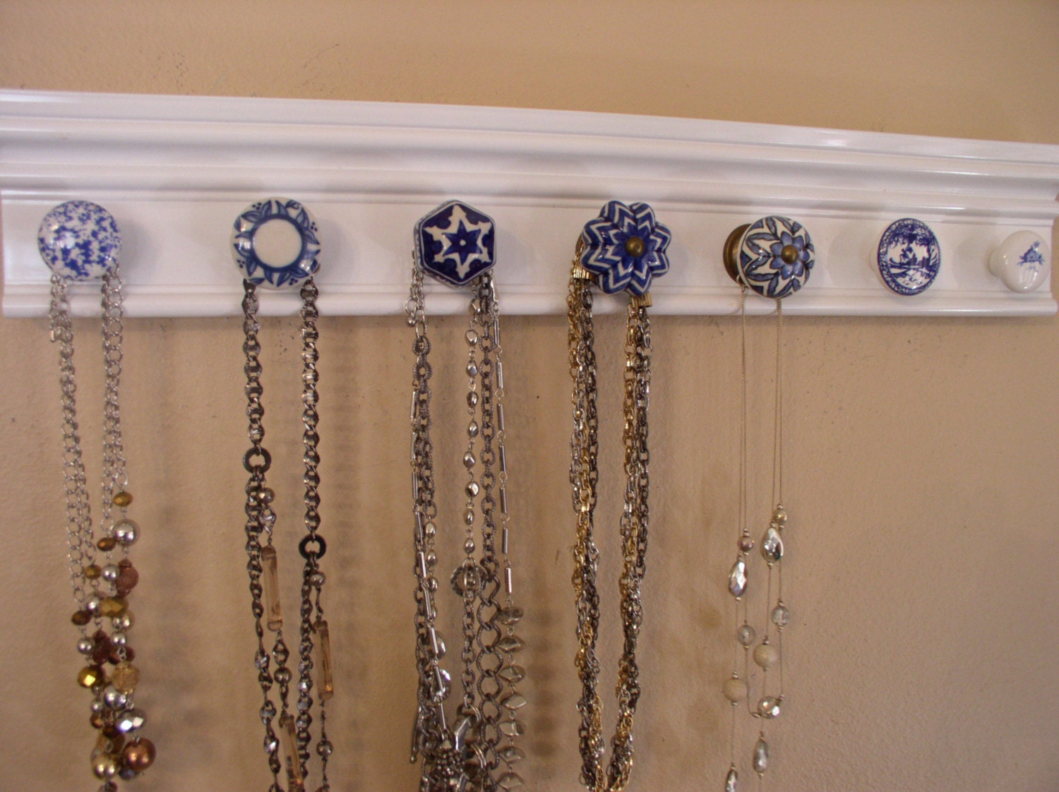 Necklace organizer. This jewelry hanger has 7 blue and white