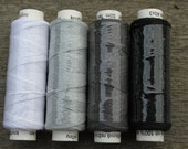 Four spools of linen thread - white, grey and black colourway