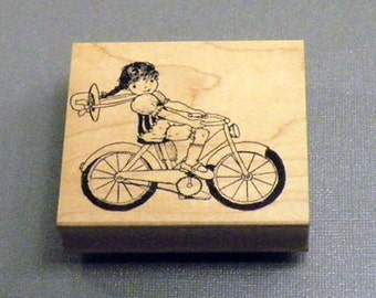 Girl Riding Bike Rubber Stamp