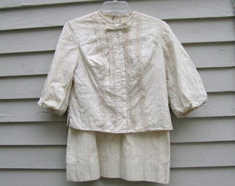Vintage 2pc. Beige suit with vertical lace bow and puff sleeves ala 1970s