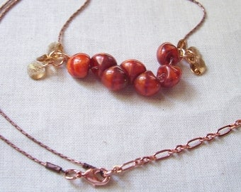 Burnt Orange Lampwork Glass and Golden Shadow Crystal Necklace on Coppery Rosy Antique Chain with Shiny Accents