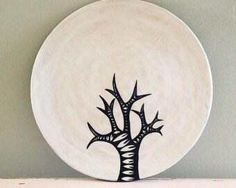 Ceramic plate, nearly black deep blue and white organic design. Tree.