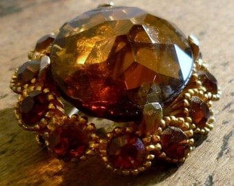 Costume Jewelry Brooch Huge Amber Paste Gem in Gilt Setting Circa 1940
