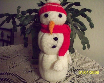 Knitted Snowman Table Decoration with Red Cap and Scarf and a Carrot Nose