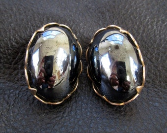 Black oval earrings, vintage hematite look cabochon gold tone clip-on earrings