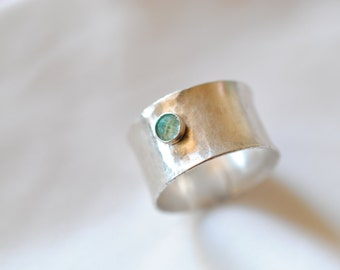 Apatite stone in a wide band silver ring - hammered texture smooth finish