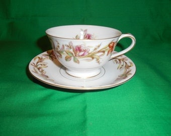 One (1), Porcelain, Footed Tea Cup and Saucer, from Sango China, in the Cynthia Pattern.
