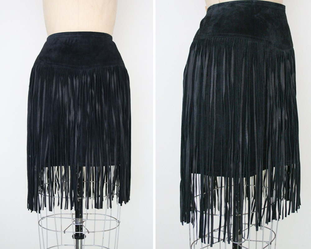 Turn heads at the pool in this cute plus size tankini skirt featuring a short black fringe. (Top not included.).