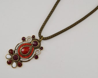 red, white and bronze pendant necklace