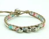 Skull charm quartz and silver beads wrap bracelet.