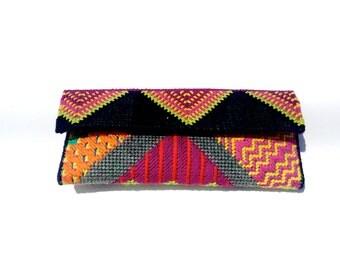 Multi pattern needlepoint clutch