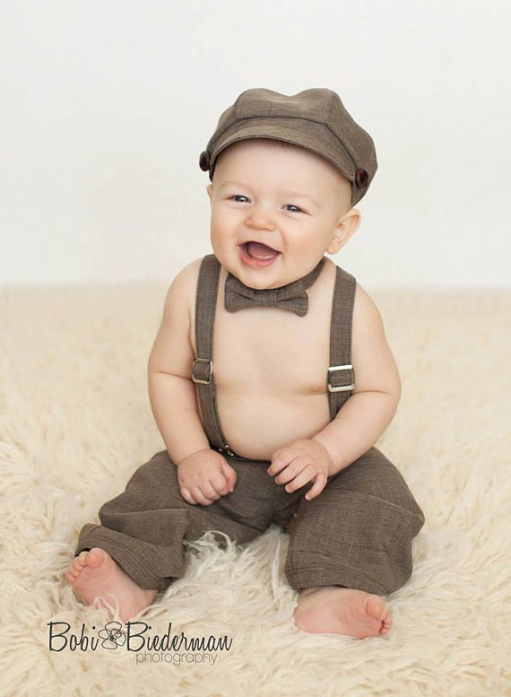 Description. Baby boys suspender dress. Full sleeve striped tops and denim pant. Separate Suspender buckles. For babies of years. Comes in two different size. and
