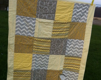 Simple, modern grey and yellow quilt for baby.