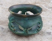 Green Ceramic Candleholder with Frog Silhouettes