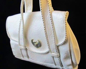 White Mod- styled pleather purse with contrasting stitching