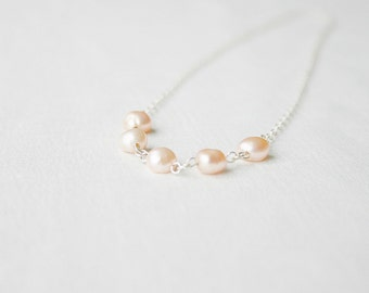Sterling silver necklace with pink pearl beads