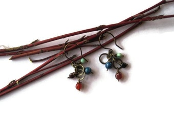 All Tied Up With a Bow Earring.  Colorful cluster of gemstones dangle from antique bronze rings. Lovely.