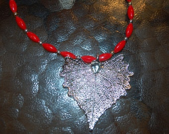Red Coral Beaded Necklace with Silver Accents and Silver Leaf Pendant
