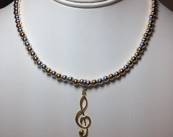 Sterling Silver and 14k Gold Musical Necklace.