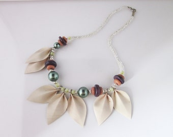Necklace in beads and leaves signed LISE