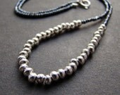 Thai Karen Hill Tribe silver bead necklace with tiny charlotte cut seed beads on a silk cord